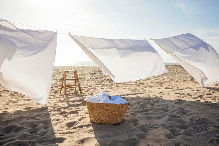 white-sheets-hanging-on-laundry-line-at-beach-siri-stafford