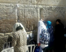 Tucking prayers into wall