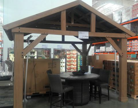 Custom built Canopy over cement patio for stone table, leather chairs, BBQ pit
