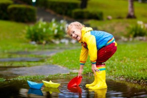 depositphotos_296481744-stock-photo-child-with-paper-boat-in