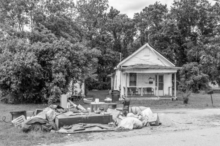 abandoned-home-trash-lawn-abandoned-home-pile-furniture-garbage-lawn-black-white-poverty-concept-145528167